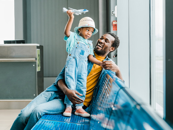 Dad and little girl waiting at airport gate
